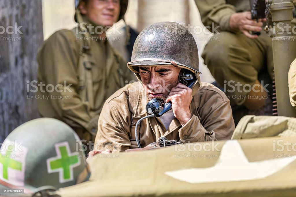 Concerned Soldier on the Phone Receiving Orders stock photo