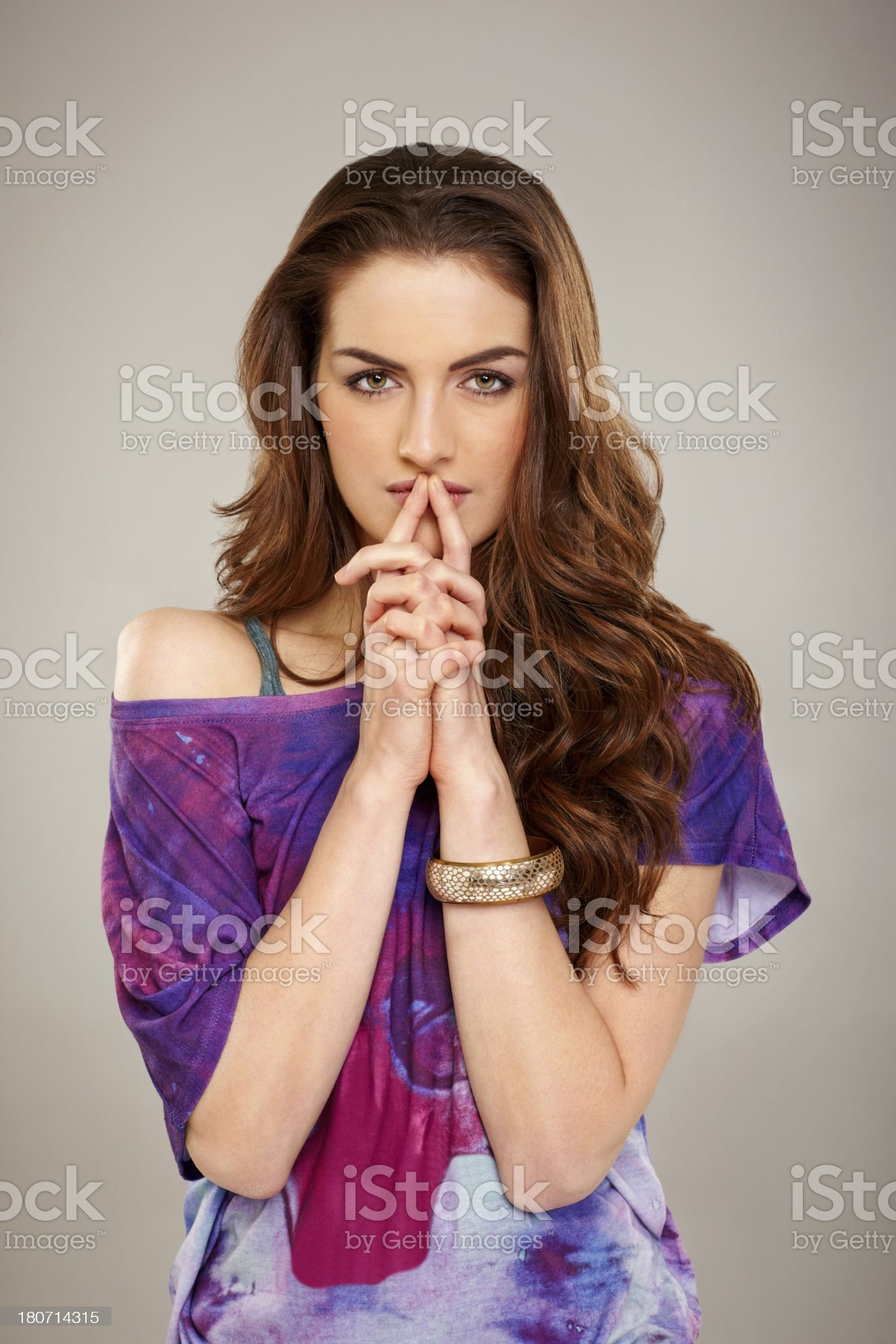 Concerned woman against grey background royalty-free stock photo