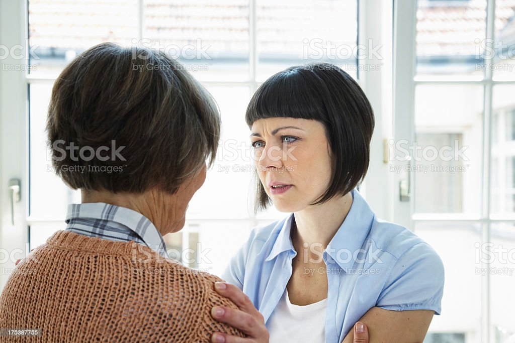 Concerned woman with senior lady royalty-free stock photo