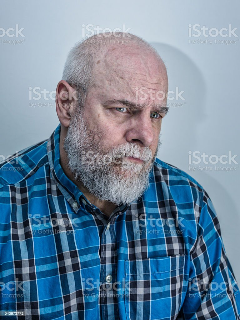 Concerned Worried Senior Adult Man Biting Lip stock photo