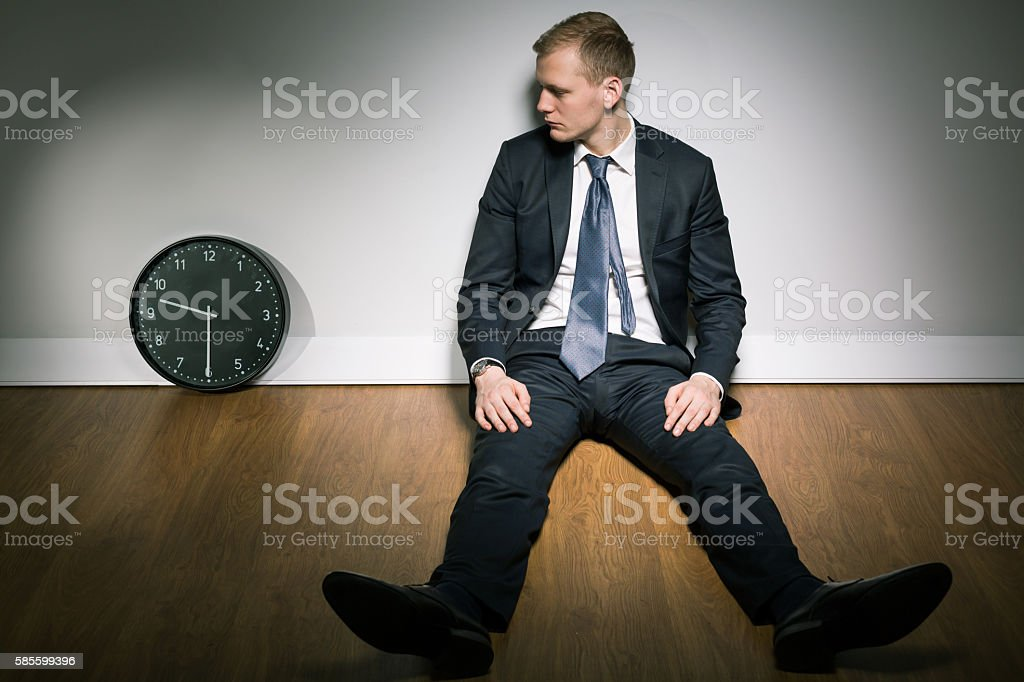 Concerned young man and passing time stock photo