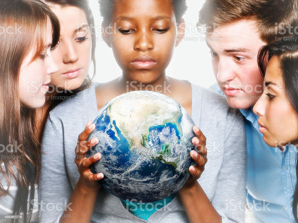 Concerned young people caring for Mother Earth royalty-free stock photo