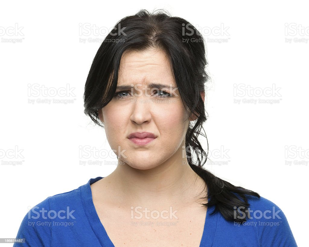 Concerned Young Woman Frowning royalty-free stock photo