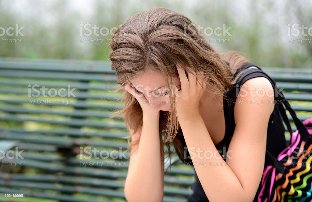 Concerned young woman stock photo