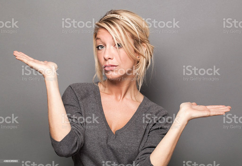 concerned young woman uncertain at choice of product or service stock photo