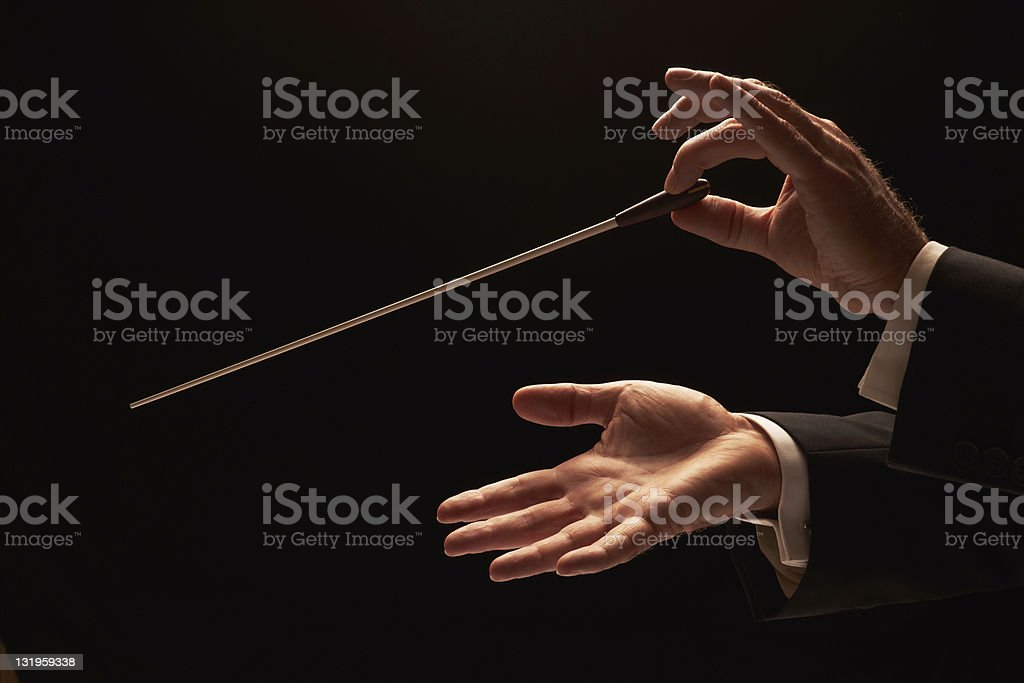 Concert conductor hands with baton stock photo