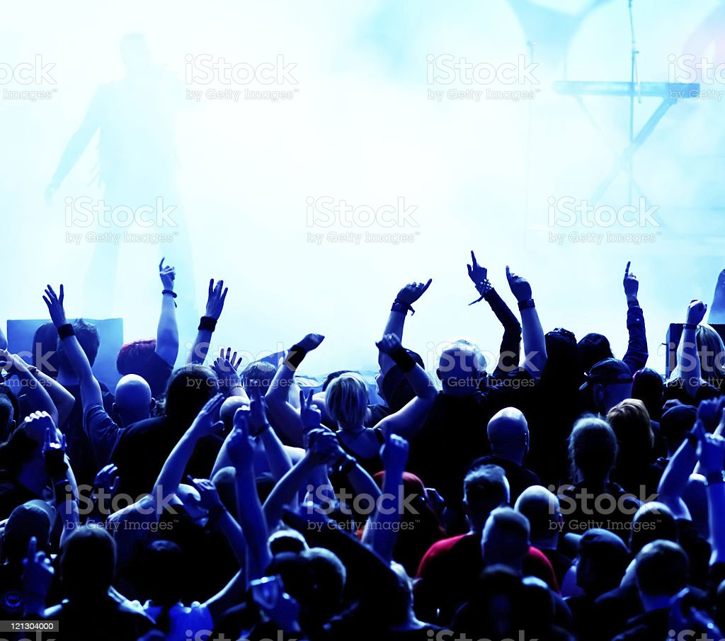 Concert crowd / bright blue stage lights stock photo