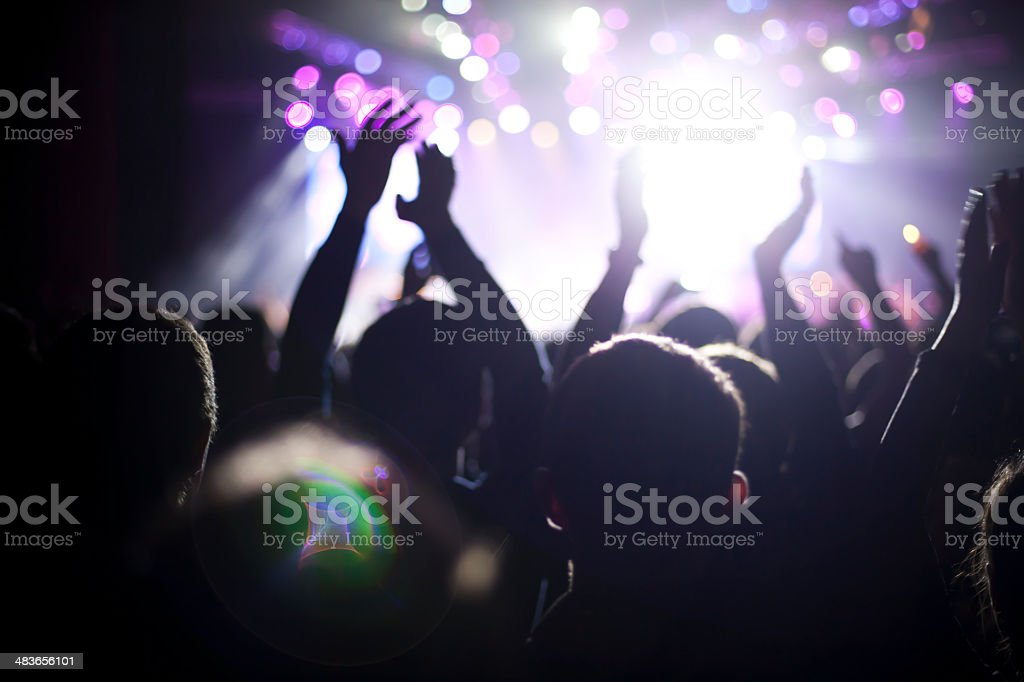 Concert crowd with a lens flare royalty-free stock photo