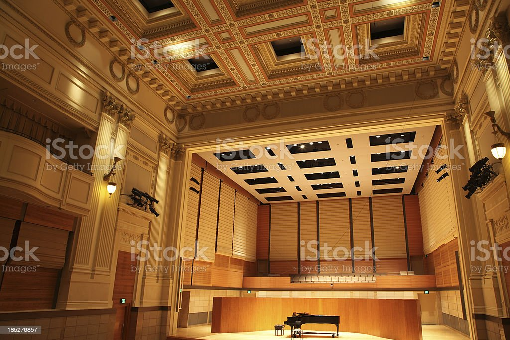 Concert Hall with Grand Piano on Stage stock photo