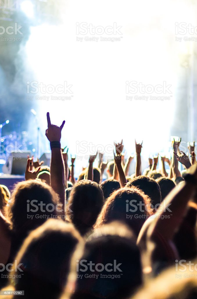 concert light live people music audience bokeh band hands up stock photo