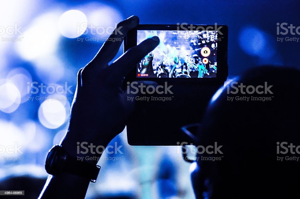 concert mobile bokeh blue unrecognizable people human live video photo stock photo