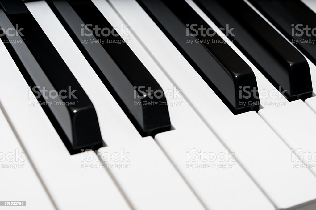 Concert piano keys white and black angle view stock photo