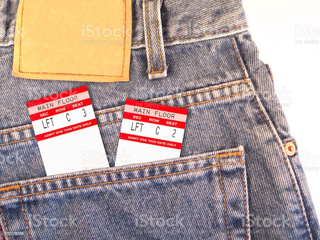 Concert Tickets in Back Pocket of Denim Blue Jeans royalty-free stock photo