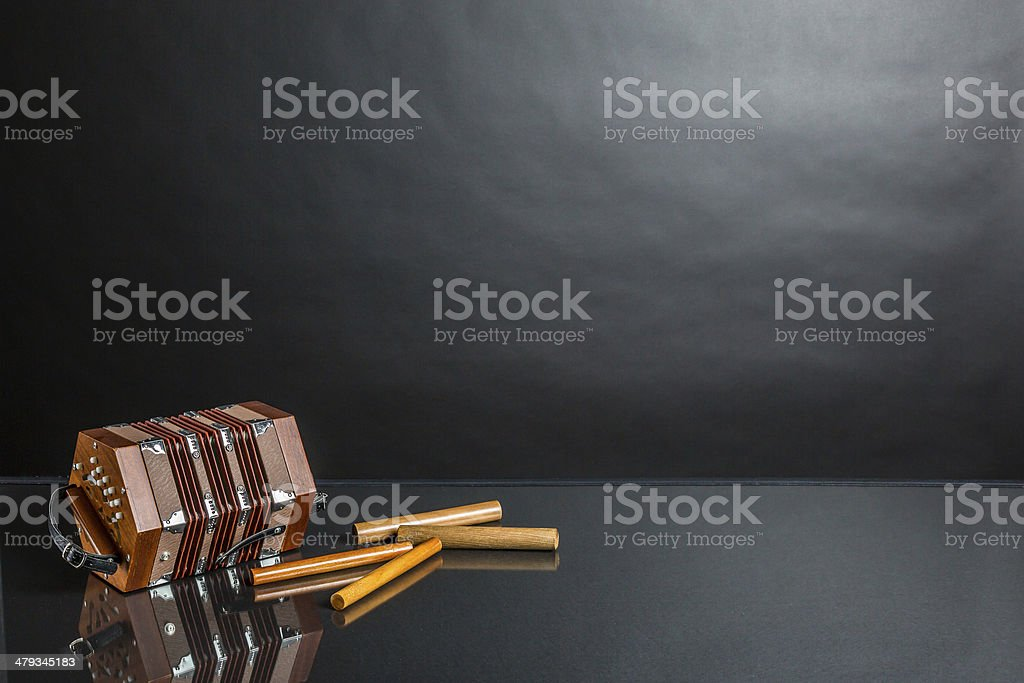 Concertina and claves stock photo