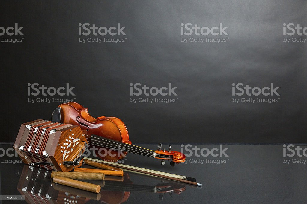 Concertina fiddle and claves stock photo