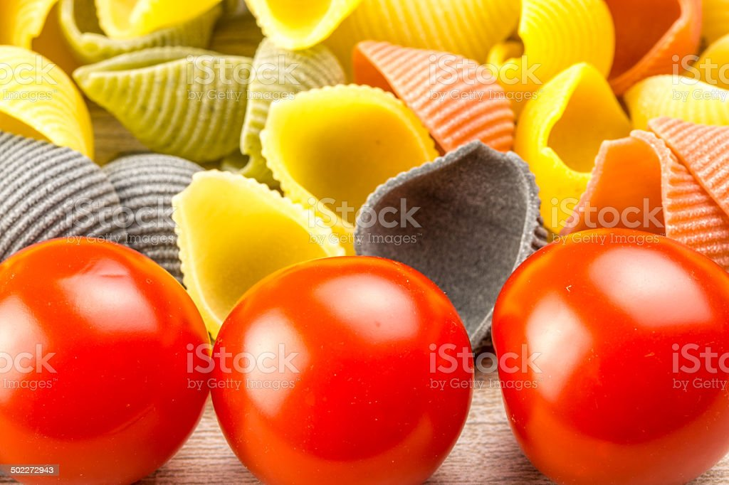 Conchiglie pasta with cherry tomatoes royalty-free stock photo