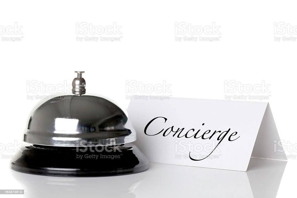 Concierge bell and nameplate against a white background stock photo