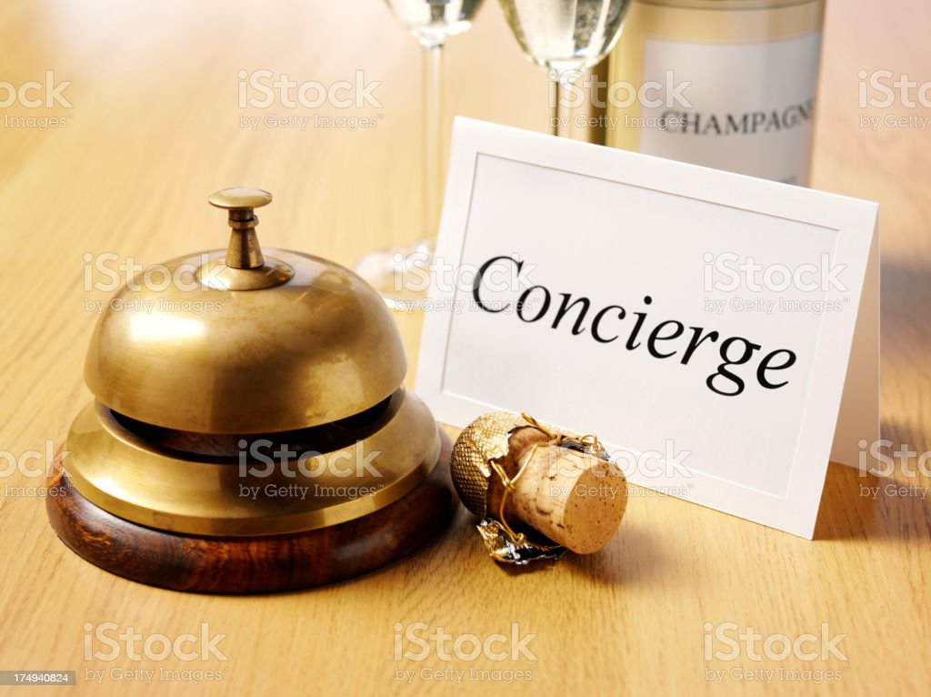 Concierge Card by a Brass Bell stock photo