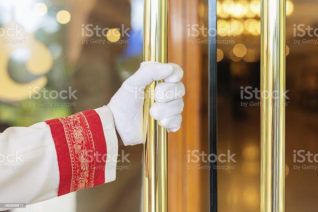 Concierge Opens the Door at Luxury Hotel Entrance stock photo