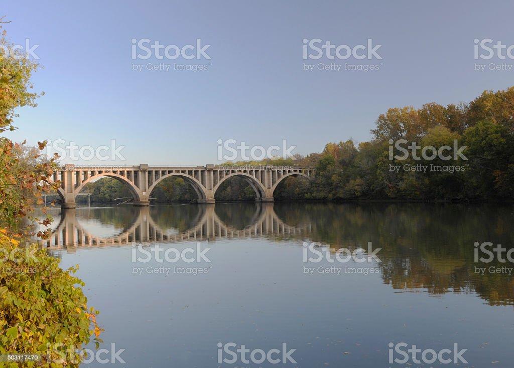 Concrete arch bridge over the river stock photo