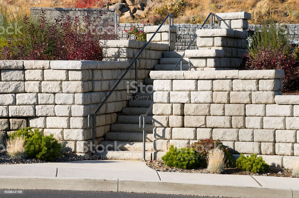 Concrete block wall  and landscape steps stock photo