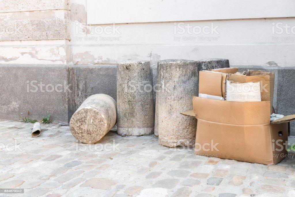 Concrete bollard and cardboard box on a street corner stock photo