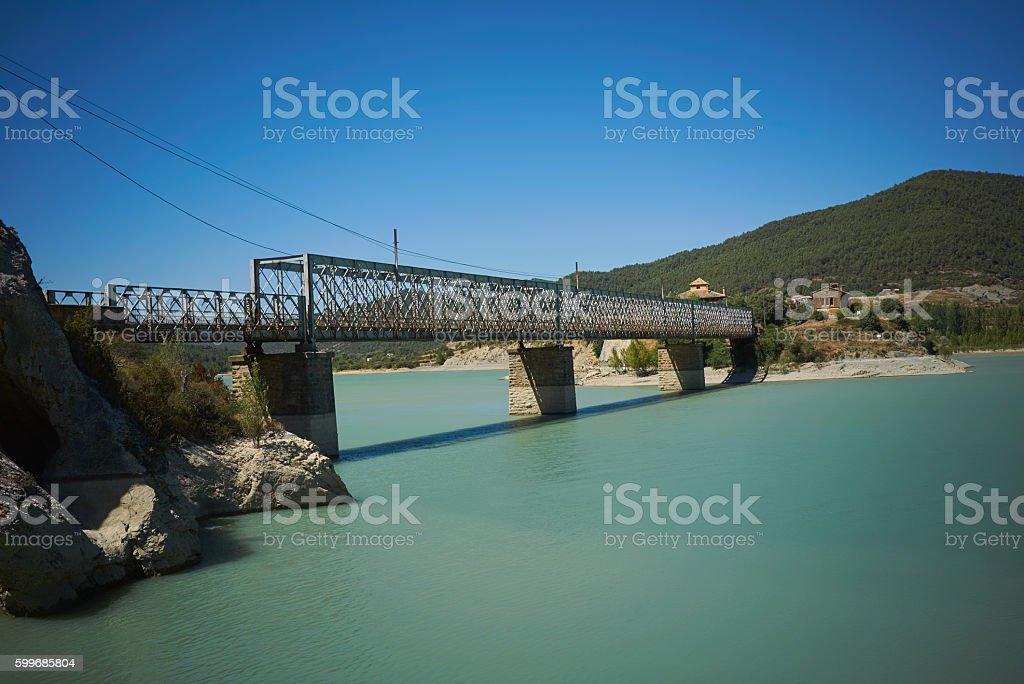 Concrete bridge over a bay among green hills stock photo