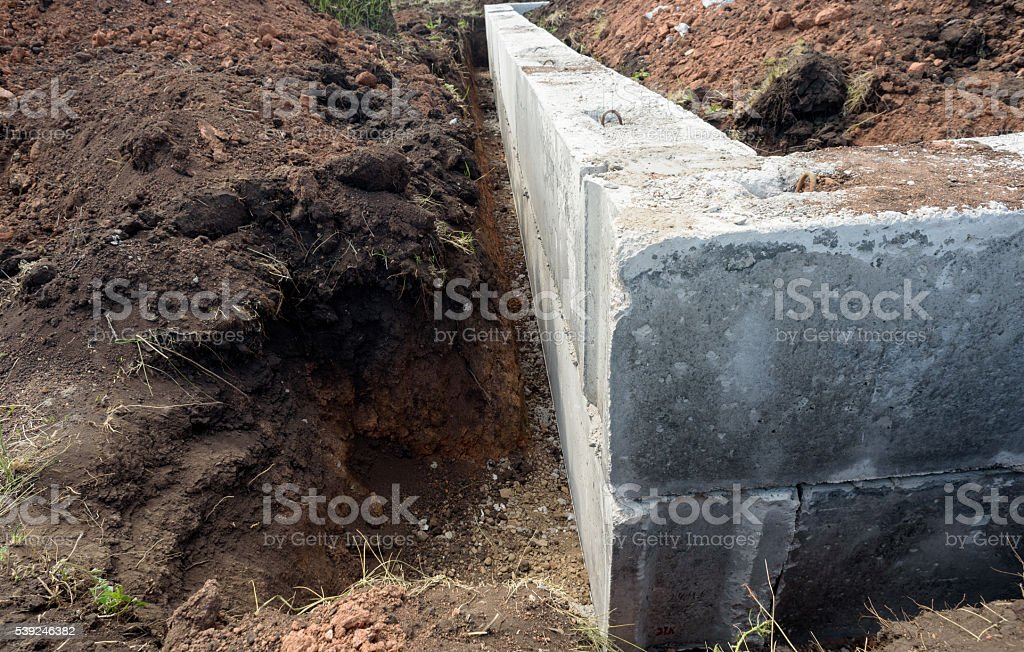 Concrete Building Block House Foundations in Earth stock photo
