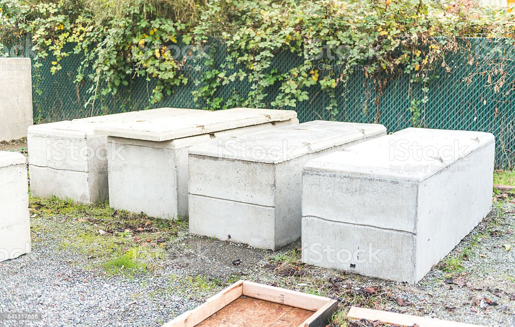 concrete coffin on the ground. stock photo