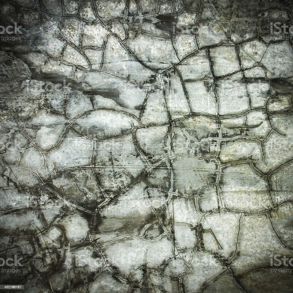 concrete crack at scratched wall texture ; grunge background royalty-free stock photo
