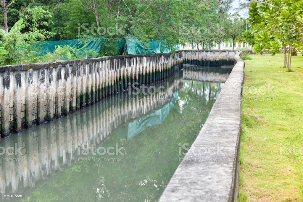 Concrete drainage canal stock photo