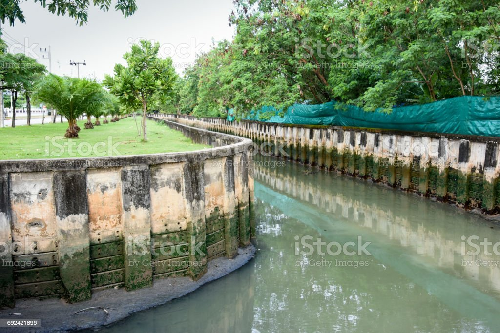 Concrete drainage canal with water pipe stock photo