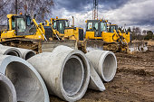 Concrete drainage pipes and bulldozers