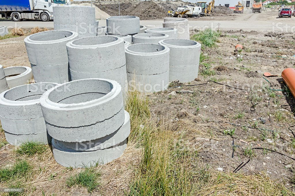 Concrete drainage pipes are on a construction site. stock photo