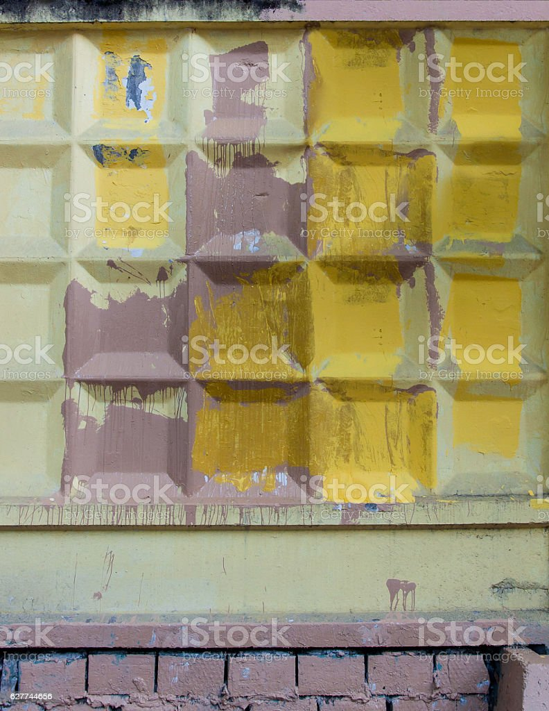 Concrete fence, covered with yellow and purple paint stock photo