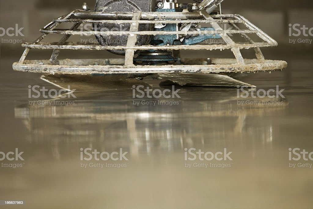 Concrete Finishing with a Power Trowel royalty-free stock photo
