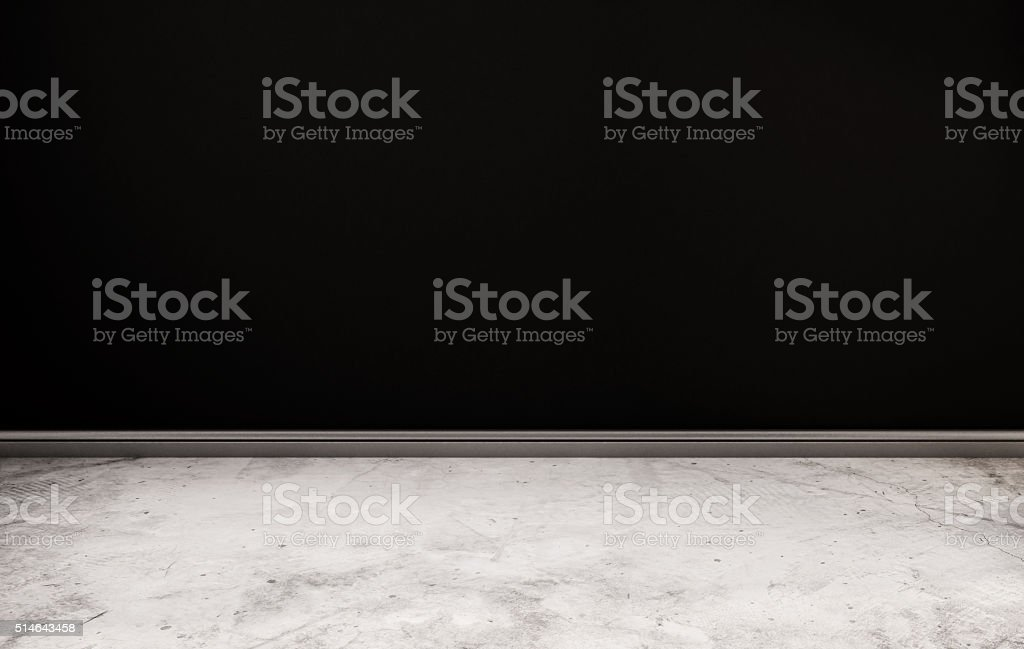 Concrete floor and black wall stock photo
