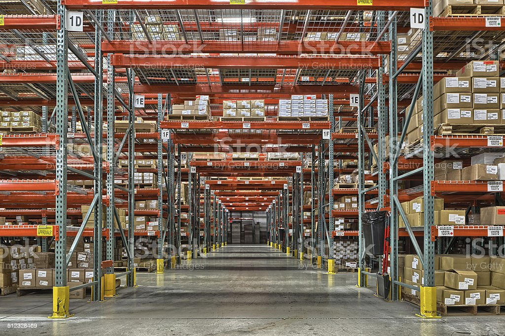 Concrete floor warehouse with high ceilings and boxes stock photo