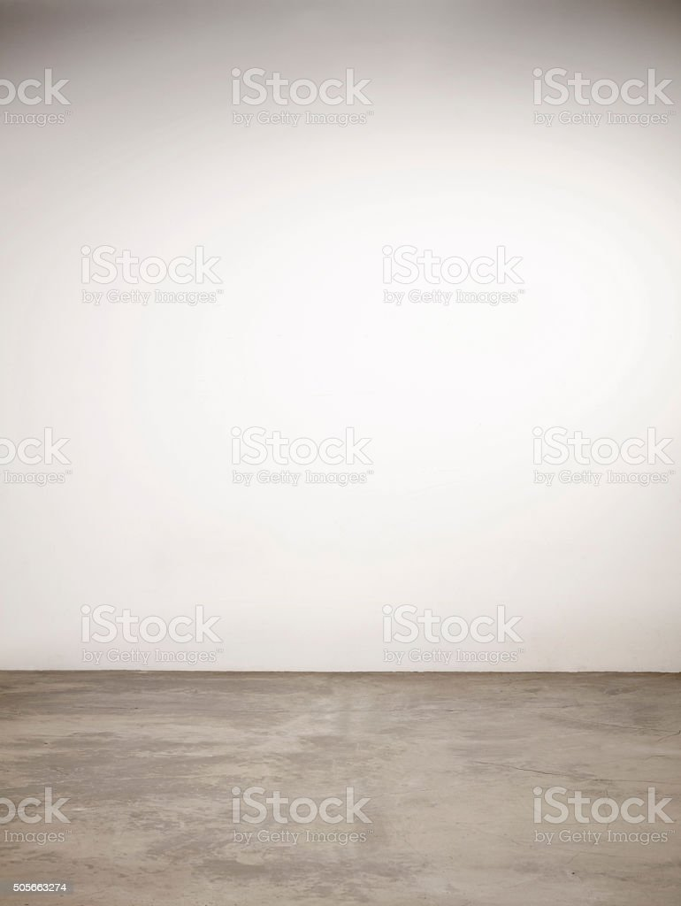 Concrete Flooring with White Wall stock photo