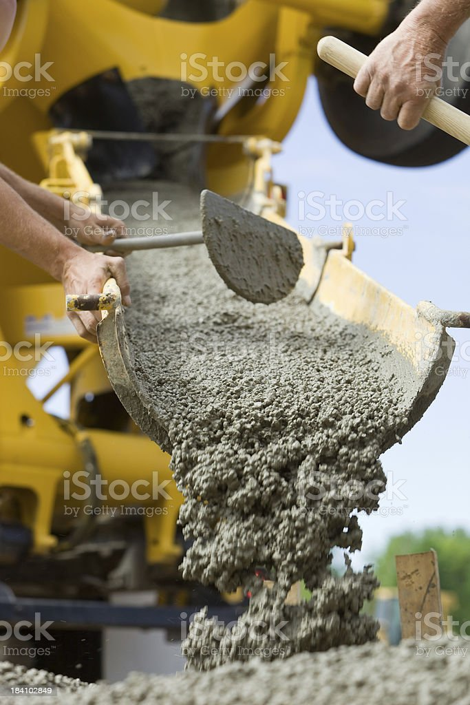 Concrete from Cement Mixer Trough for Sidewalk royalty-free stock photo