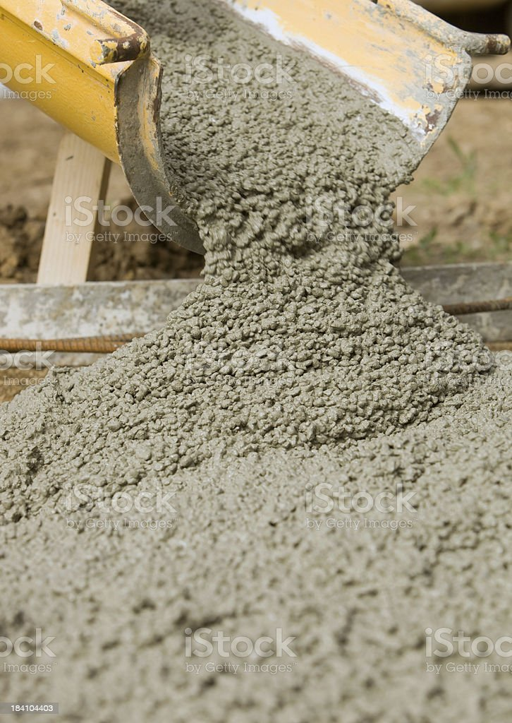 Concrete from Cement Mixer Trough for Sidewalk stock photo