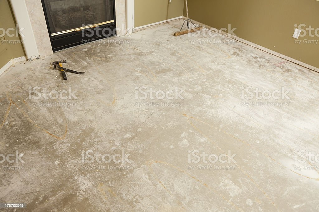 Concrete House Floor with Broom Ready for Flooring Installation royalty-free stock photo