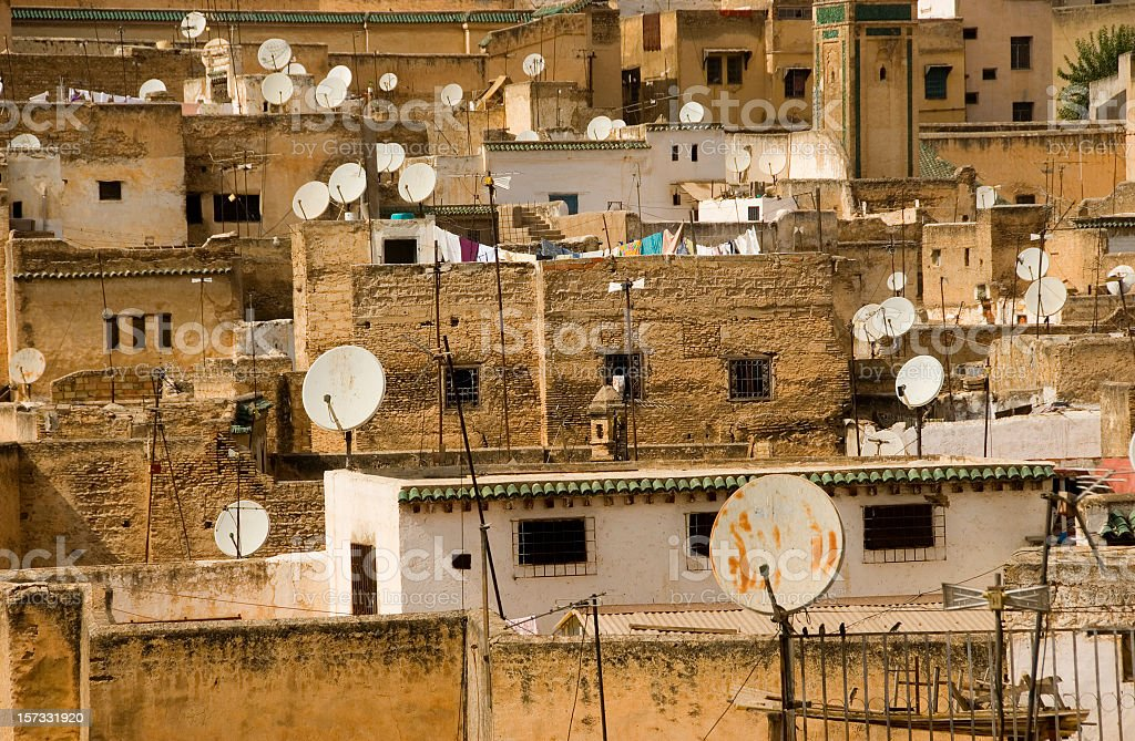 Concrete housing with multiple satellite dishes stock photo