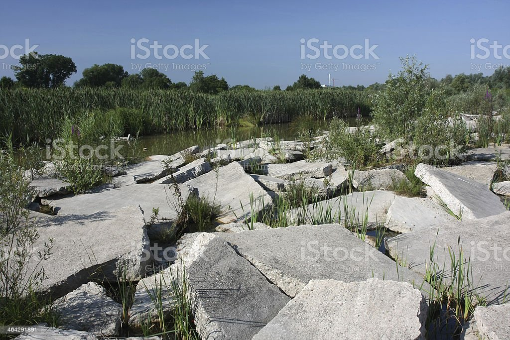 concrete in nature with lake behind royalty-free stock photo