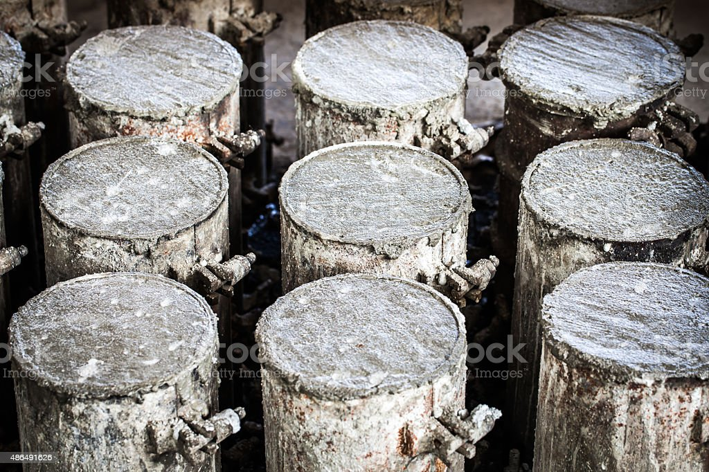 Concrete in steel cylinder formwork for testing of strength comp stock photo