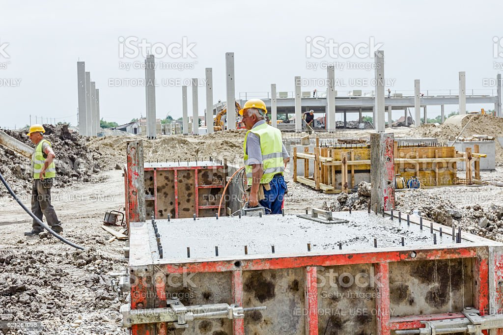 Concrete is leveling after pouring stock photo