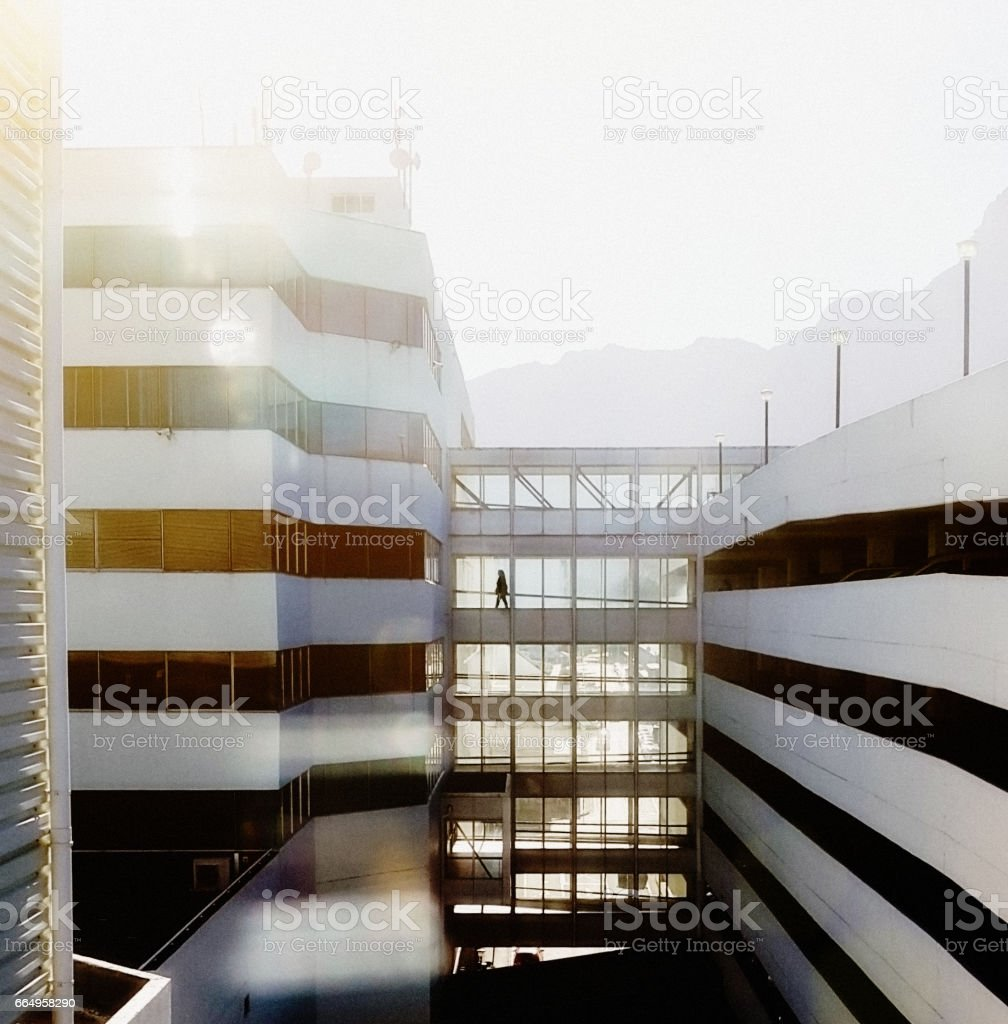 Concrete Jungle: complex of urban office blocks joined by walkways stock photo