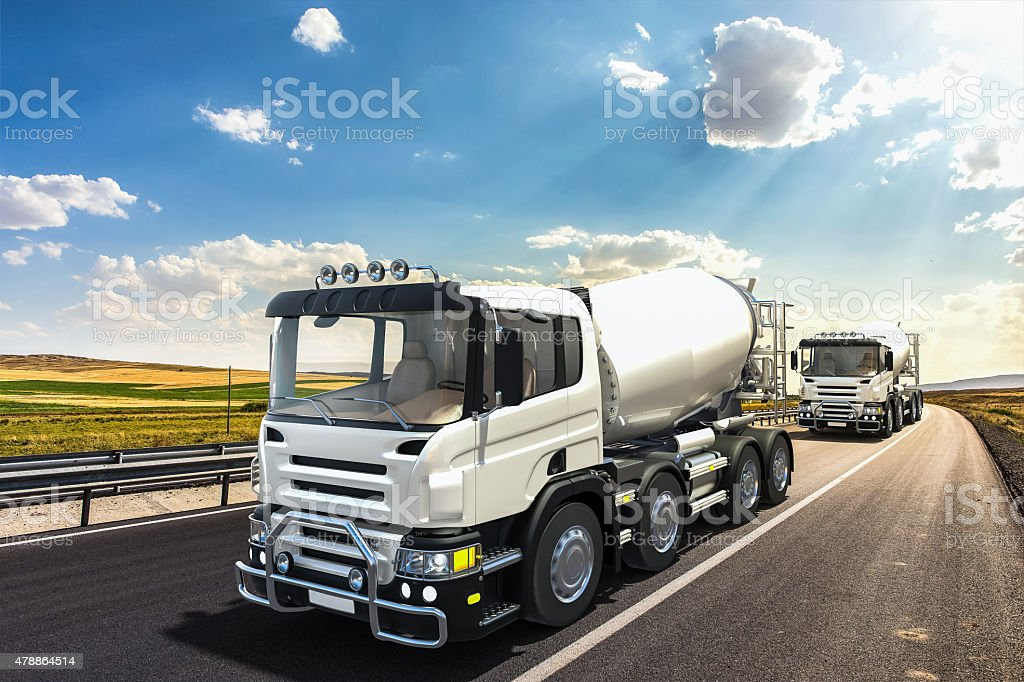 Concrete mixer trucks on the road stock photo