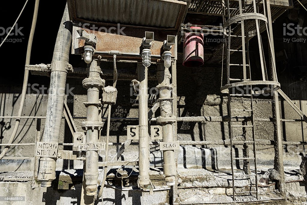Concrete mixing plant with labeled pipes stock photo