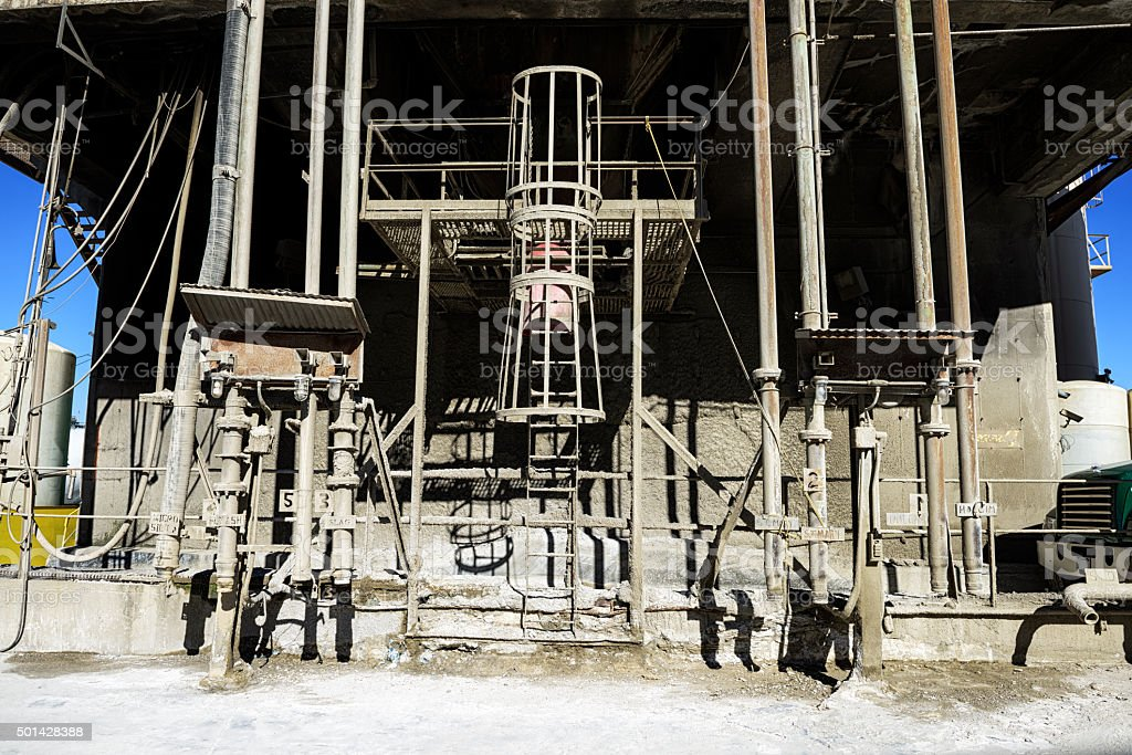 Concrete mixing plant with pipes stock photo